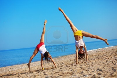 9967057-beautiful-girls-having-fun-at-beach